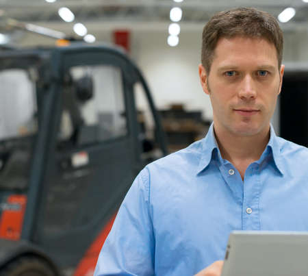 supervisor: Handsome supervisor with tablet pc at warehouse.