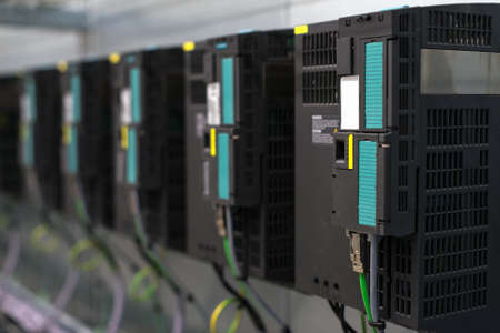 electricity providers: Close-up view of industrial converters at factory.