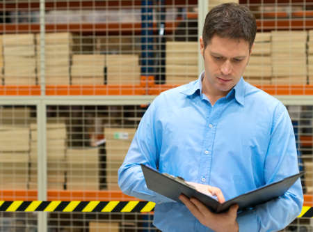warehouseman: Handsome manager with clipboard in post office.