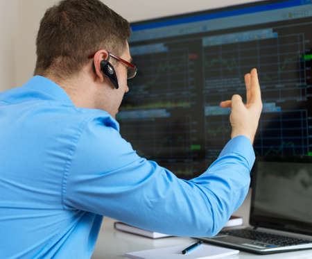 stock trader: Angry stock trader in front of computer.