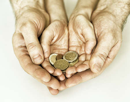 young  family: Dad and his daughter holding euro coins. Stock Photo