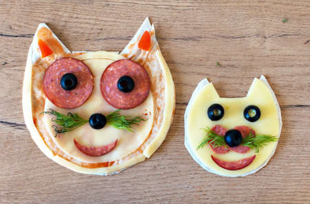 childrens food: Handmade pizza in the form of cat. Stock Photo
