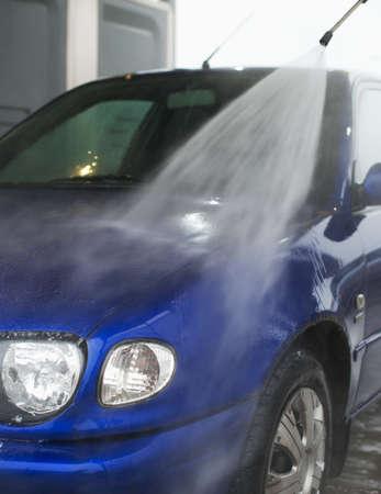 water jet: Car wash using high pressure water jet. Stock Photo
