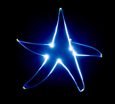 speed of light: Blue star. Speed light painting. Freeze Light. Stock Photo