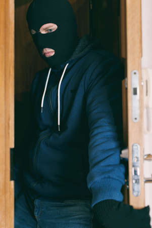 private property: Thief entering the private property. Stock Photo