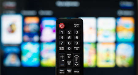 operating system: TV remote control against SmartTV operating system.