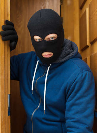 rapist: Thief entering the private property. Stock Photo
