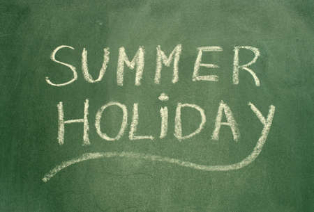 green chalkboard: Summer holiday text on green chalkboard. Stock Photo