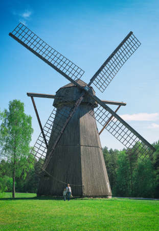 old people: Old estonian windmill with two people. Size matters!
