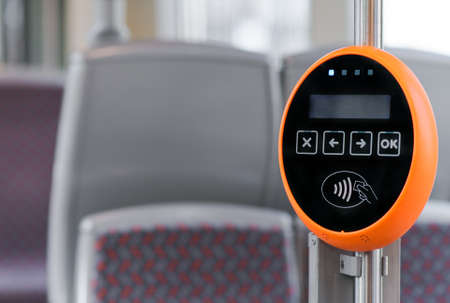 validating: Ticket validation system on modern public transport. Stock Photo