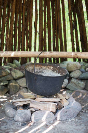 culinary tourism: Pot for cooking over the fire.