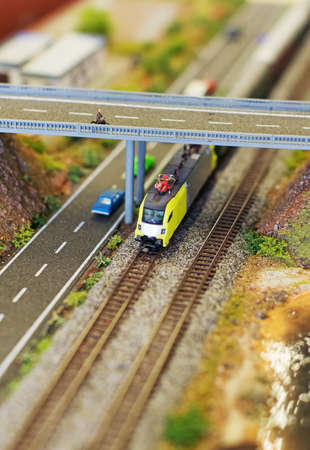 miniaturization: City in miniature. Electric train near the speedway.
