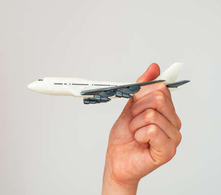 model airplane: Child hand holding model airplane. Place for text.