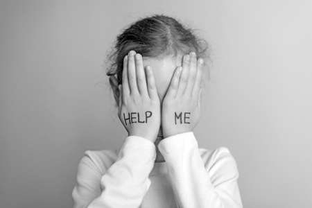 need help: Child need help. Little girl crying. Black and white.