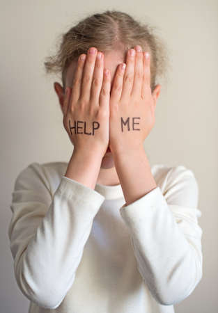 need help: Child need help. Little girl crying. Stock Photo