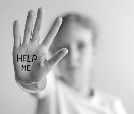 need help: Child need help. Violence concept. Black and white. Stock Photo