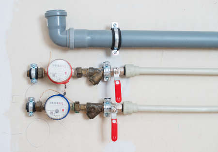 undone: Water meters installed on the pipe and ready to connect. Stock Photo