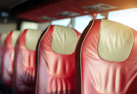red leather: Empty red leather seats in tourist bus. Stock Photo