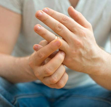 unfaithful: Divorce concept. Man taking off wedding ring. Stock Photo