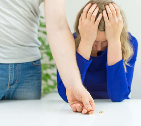 Divorce concept. Man returning wedding ring to his wife. Stock Photo