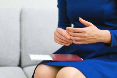 Divorce concept. Woman taking off wedding ring. Stock Photo