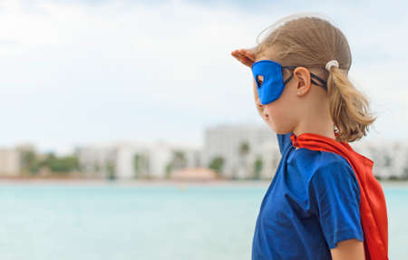 looking into: Superhero kid looking into distance.