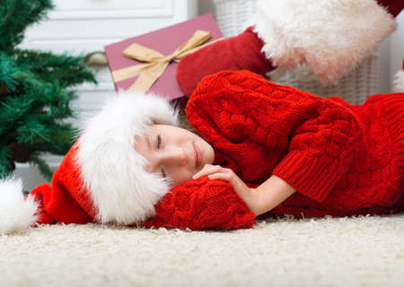 Santa Claus delivering presents while kids are sleeping. Stock Photo