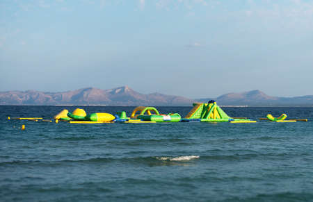 Inflatable sports equipment in the sea. Stock Photo