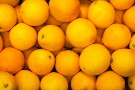 Lots of bright oranges in supermarket. Stock Photo