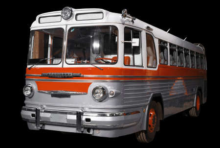 Old retro orange bus. Isolated on black background. 写真素材