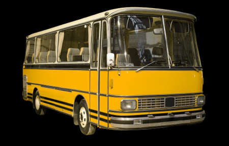 Old retro yellow bus. Isolated on black background. 写真素材