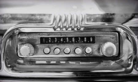 Old radio in retro car.