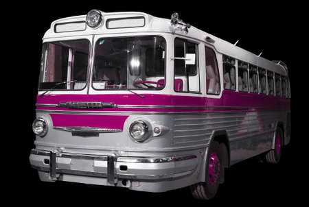 Old retro pink bus. Isolated on black background. 写真素材