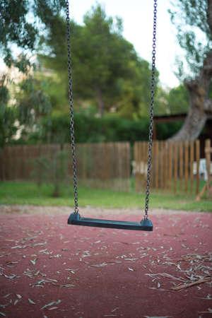 Empty swing in the backyard.