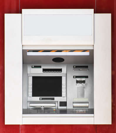 bankomat: Built-in ATM machine on the street. Stock Photo