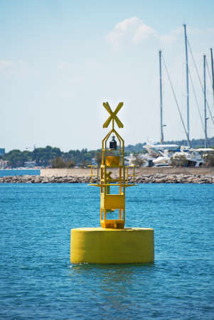 Floating yellow navigation buoy in the sea.