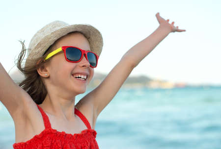 arms wide open: Summer vacation concept. Smiling girl with arms wide open.