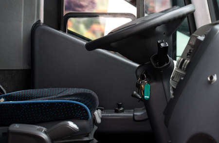 Seat and steering wheel. Bus drivers seat.