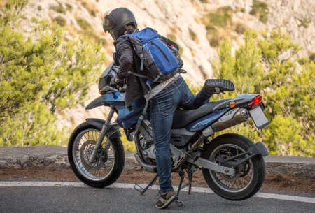 motobike: Tourist using motorcycle in mountains.