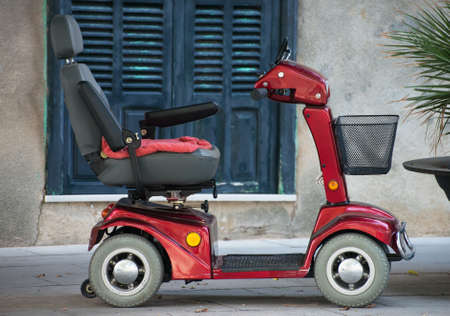 Motorized wheelchair car for disabled people.