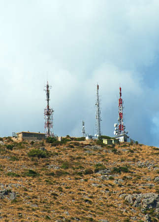 Telecommunication towers with antennas on the hill. Stock Photo