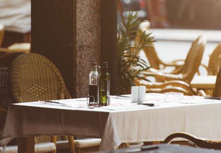 Mediterranean restaurant terrace exterior with chairs.