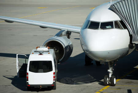 Passenger plane in the airport. Aircraft maintenance. Stock Photo