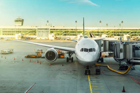 hosepipe: Passenger plane in the airport. Aircraft maintenance. Stock Photo