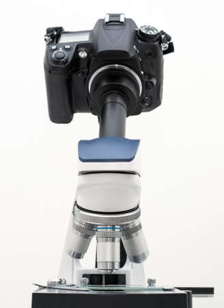 DSLR Camera attached with adapter to microscope. Stock Photo