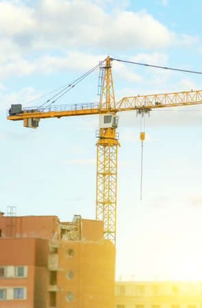 Working crane in the sky. Construction site. Stock Photo