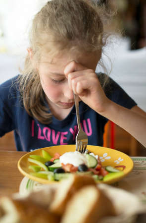 Little girl dont want to eat meal in restaurant.