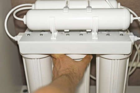 Installation of reverse osmosis water purification system.