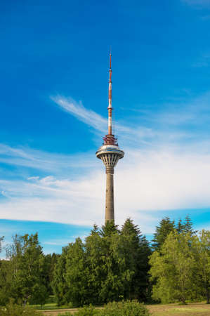 Tallinn TV Tower over blue sky.