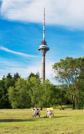 Family resting near Tallinn TV Tower. photo